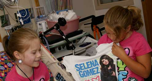 Bella Tucker getting gifts from Selena Gomez