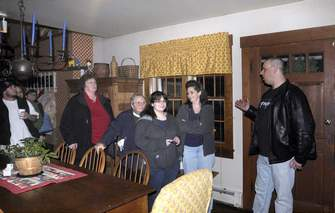 Michael Lazdauskas leads a group of ghost hunters through the Harley House on Saturday. (T&G Staff Photos/MARK C. IDE)